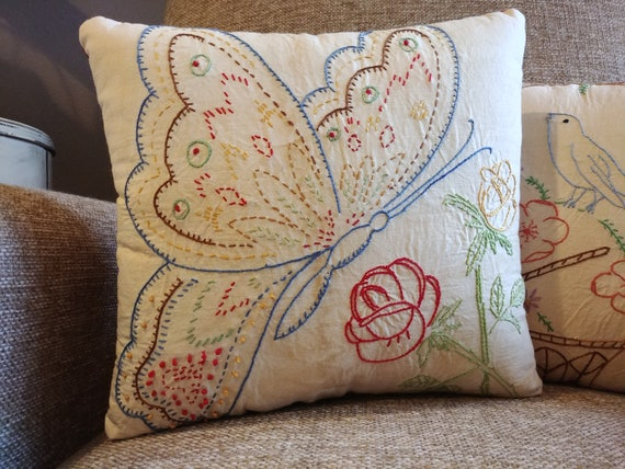 Small decorative pillow from vintage butterfly embroidery square