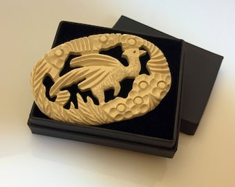 Huge early plastic vintage bird or griffin brooch c. 1930s - off white
