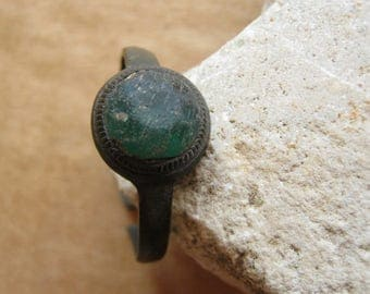 Antique vintage bronze ring with colored green glass stone