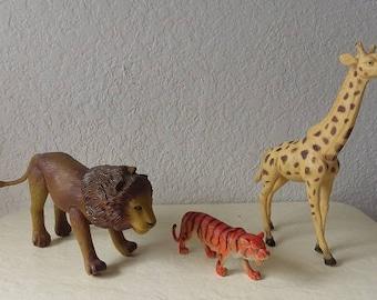 Three PVC Wild Animals, Lion, Tiger and Giraffe.