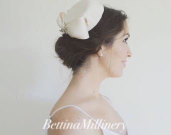 Ivory silk pillbox hat with bow and antique brooch. French birdcage wedding veil. Handmade in Australia by Bettina Millinery.