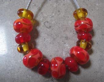 Lampwork Glass Bead Set. Orange, Coral and Amber Waves and Dots. Handmade Glass Beads. Australian Artisan Glass Beads. Kiln Fired Beads.