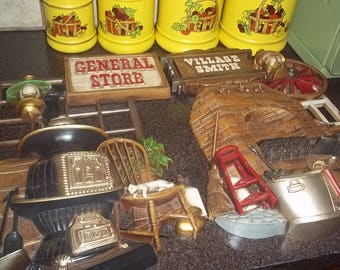 2 Vintage Burwood Productions Mid-Century Wall Hangings of Village Smith and General Store 1978