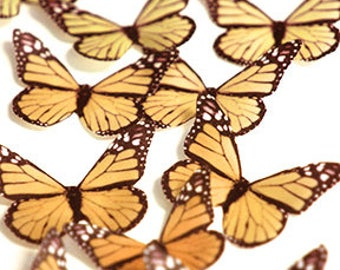Orange edible butterflies, 12 wafer paper monarch butterflies for cake decorating and cupcake toppers. Butterflies for wedding cake toppers