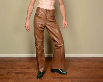 vintage 60s 70s brown leather bellbottom pants leather flare pants Goya de Espana hippie boho 1960 1970 32x34 32 waist