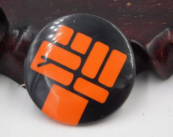 Vintage Black and Red Fist Protest Pin Pinback Button Marked First Publishing dr30