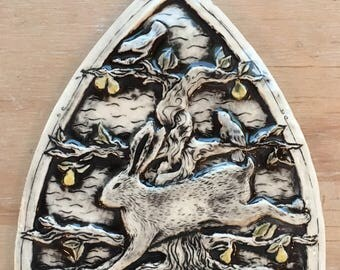 Handmade ceramic tile with rabbit, bird and pear tree, black wash with gloss finish