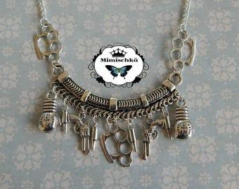 necklace rockabilly pin up hand knuckle bullet gun