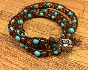 Turquoise, tiger's eye, & crystal leather wrap bracelet.