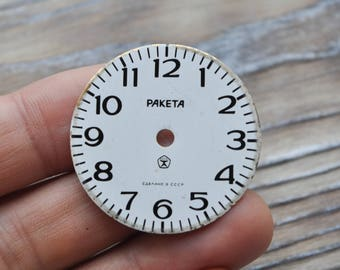 Vintage RAKETA mini alarm clock face.