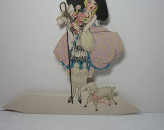 Art Deco 1920's-30's die cut unused Buzza place card adult Little Bo Peep wears elaborate outfit with mesh fingerless gloves