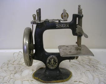 Antique Singer Child's Toy Sewing Machine with Hand Crank
