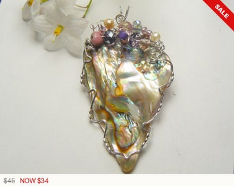 Abalone shell hand polished and wire wrapped with sterling silver wire, teardrop shape, very bright polish (w92261)