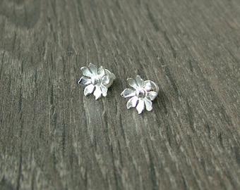 Sterling silver flower stud earrings.