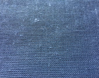 Loosely woven blue cotton blend vintage fabric.