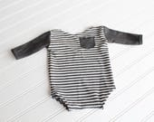 Jailhouse Rock - newborn long sleeve body suit romper in a white waffle knit stripe  with charcoal grey knit sleeves and pocket  (RTS)