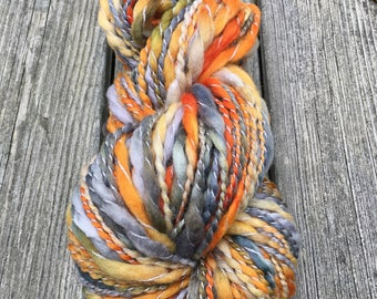 Handspun Yarn, Art Yarn, Bulky, Thick and Thin, 2 Ply, Coil Ply, Wool, Merino, Spiral Ply, Splattered Creamsicle