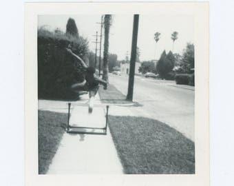 Vintage Snapshot Photo: Sidewalk Hurdler (78600)