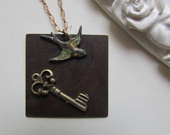 Vintage necklace and romantic bird and key