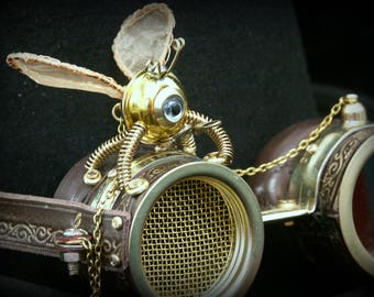 Steampunk goggles in brown leather and brass with folding lens, decorative winged  automaton,golden mesh and embossed decoration