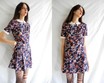 60's mod blue/white/orange floral print short sleeve pleated shift/mini dress with white contrasts.