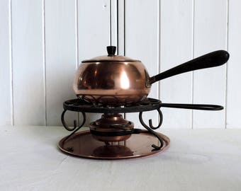 A vintage Metawa Holland fondue cooking pot, stand, base plate and alcohol burner