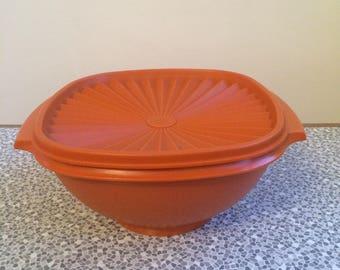 Vintage orange Tupperware container with lid