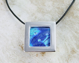 Deep dive. Unique silver plated gallery pendant with one of a kind fused glass.