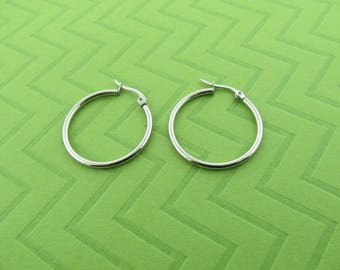 stainless steel hoops. 1 1/4 inch diameter
