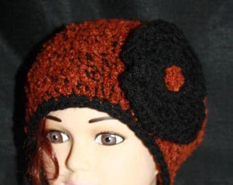Brown and black hat with a big flower