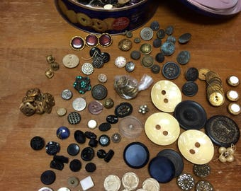 Large lot of vintage, antique, military buttons in an old biscuit tin.