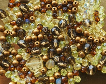 Fire polished beads, crystals, lemons, browns, gold