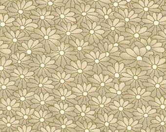 Gold embellished daisy fabric.