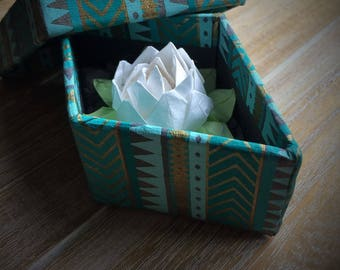 Origami lotus in a gift box