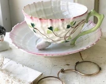 A Belleek Shamrock Neptune shape tea cup and saucer