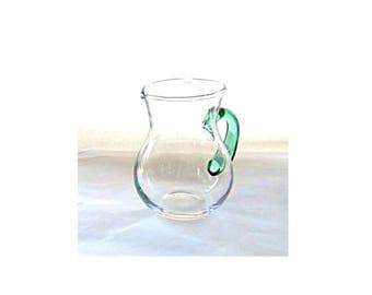 Hand blown glass creamer or small pitcher with green handle