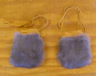 "2 Slate Blue Rabbit Fur Bags. Measures 4"" long, 3 1/2"" wide."