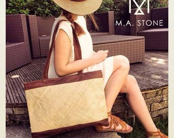 Large tote bag in camel leather and straw.