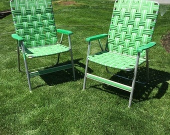 Pair of green webbed lawn chairs