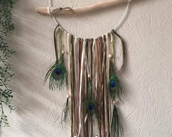 Large dream catcher with driftwood, peacock feathers