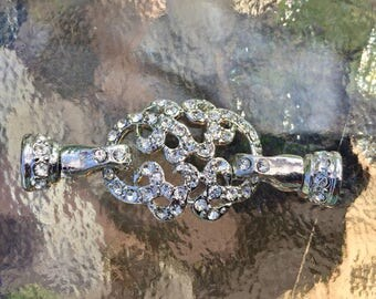 silver plated with rhinestones easy on and off, both end open magnetic clasp