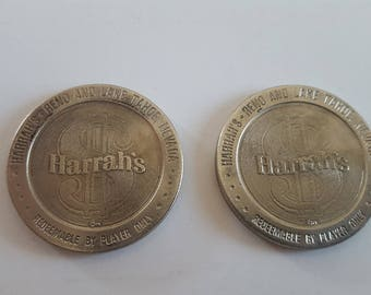 Vintage pair of slot machine tokens Harrahs Reno and Lake Tahoe, Nevada,  gambling tokens 1.00 value