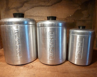 Vintage aluminum canisters- set of 3