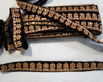 Black floral Embroidered trim golden  rhinestones.