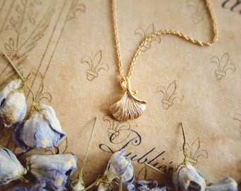 Tiny ginkgo leaf necklace pendant matte gold