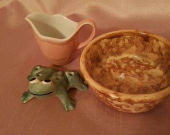 Pottery  frog, child's creamer, and Bennington bowl