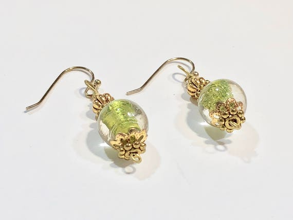 Handmade translucent green round glass bead earrings with gold plated ear wires and beads