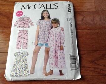 McCall's pattern M6831  girls  Size 7-8-10-12-14  New uncut