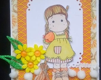 "card scrap, stamp ""tilda and her broom"" orange and yellow daisies"