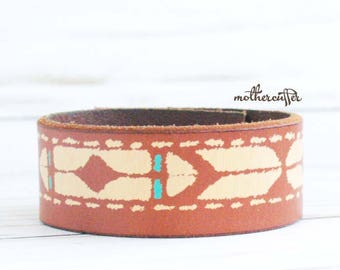 CUSTOM HANDSTAMPED narrow brown leather cuff with turquoise design by mothercuffer